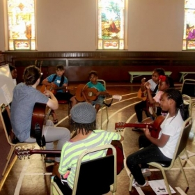 Teaching a guitar class during a music summer camp in Philadelphia