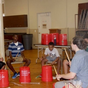 Teaching a bucket drumming class