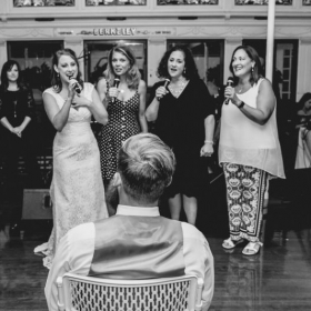 Singing with my barbershop quartet to my husband.