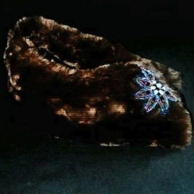 A simple and fun winter accessory. Faux fur collar with beaded clasp or tie
