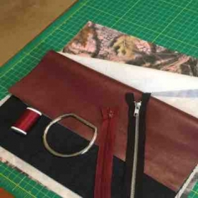 Beginnings of a denim and leather clutch