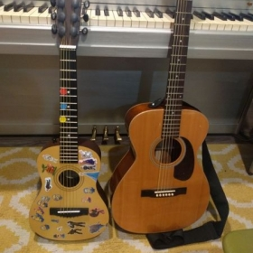 Young students guitar decorated with reward stickers!