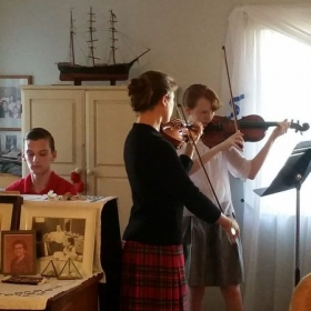 playing collaborative music with violin and piano students