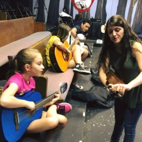 Teaching guitar class at the Swamplight Theatre