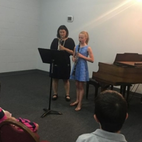 Me playing a duet with my student at my Student Recital last May.