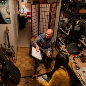 With a student in my studio—from an article about me in The New York Times