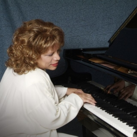 Miss Linda Capturing a Mood at Her Piano