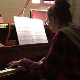 A student studying and performing Beethoven's Moonlight Sonata.