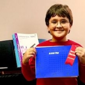 Aaditya's award from participating in the Queen City Music Fest