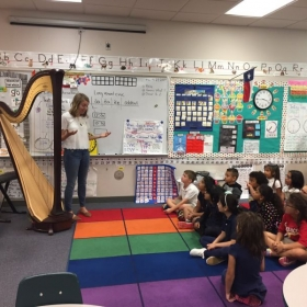 Harp demonstration to a class of 1st grade students