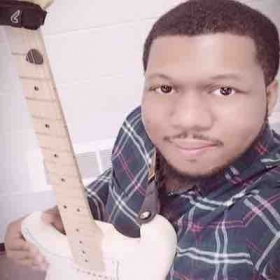 Me and Desdemona (my American Professional Stratocaster)taking a selfie together after class!