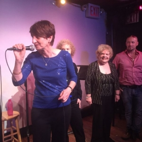 Adult students performing in New York City at Don't Tell Mama cabaret.