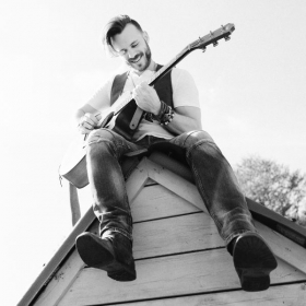 Just sitting on the roof learning chords...you know...like you do.