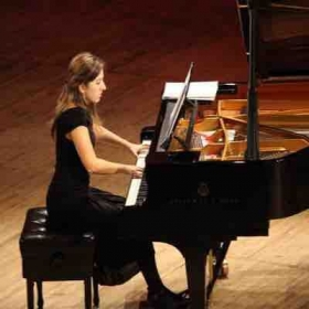 Playing a recital.