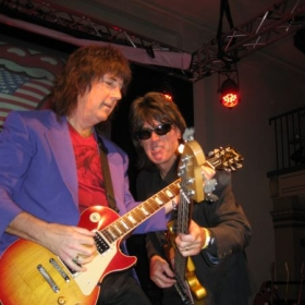 Playing on stage with Kenny Crampton on bass.  Serious rock, folks...or is it?