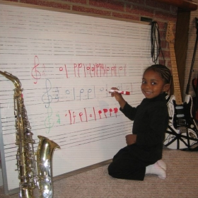 Toddler Music students learn how to read and write notes while having lots of musical fun too!