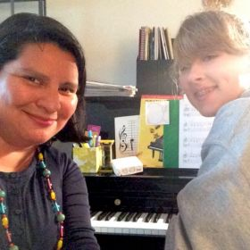 With my teen student, who learned to beautifully play through her book of Christmas piano music recently!