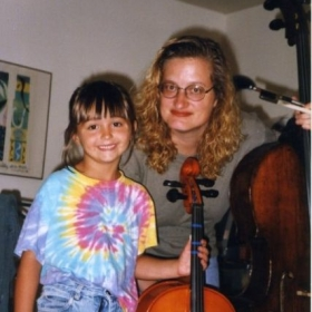 This is a picture of me with my first cello teacher