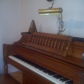 My first (and still favorite!) piano - which my parents purchased for me when I was just eight years old!