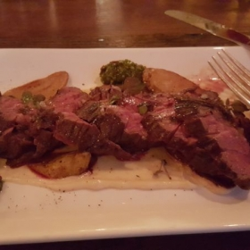 Sauteed Flank steak with roasted potatoes and caper sauce.