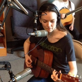 Rachel playing an original song on River Trade Radio, a local show in Kansas City, Missouri.