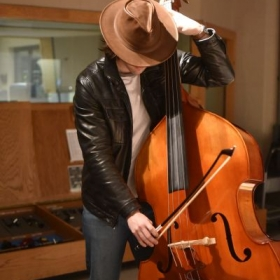In the studio playing and tracking the Upright Bass.
