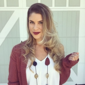 Forward curls with curling iron and bold lipstick