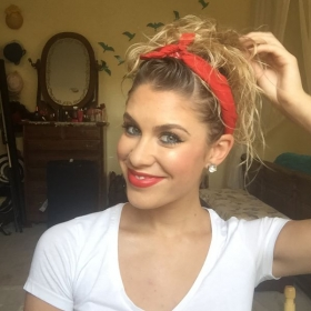 curly hair clipped up with front twist and bandanna