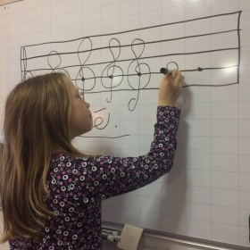 Chloe perfecting her treble clefs.