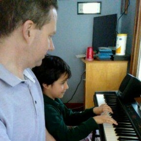 Learning notes on the black keys and even playing fun duets.