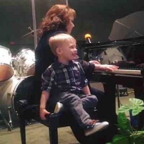 My 3-year-old grandson giving moral support as I rehearsed for my mom's celebration of life.  March 2, 2018  He loves to play piano too!