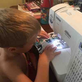 Teaching the little ones some basic sewing techniques. He's very excited to be doing a project all by himself (with supervision)!