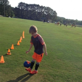 Kian juggling the ball during session