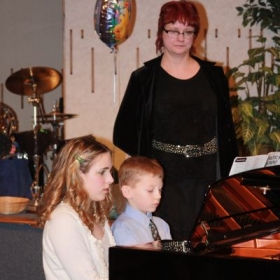 This picture is ..5 years ago:) These  two exceptional students gave  their own joint full recital and performed two duets.