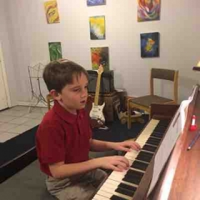This is one of my students. He takes piano and guitar lessons.  His sister took from me 15 years ago.