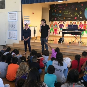 Teaching a music lesson to the students of Lexington Elementary.
