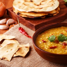Red lentil soup and fresh naan bread.