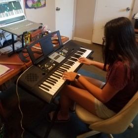 Students learn their favorite songs and technique on piano.
