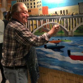 "Volunteered to join 50 artists for the 2018  Illinois Alzheimer event ""Unforgettable Art"".  Here I am painting ""Rock River Racers""."