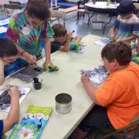 1st grade found object painting with sculptural aspects.