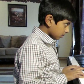 FEATURED STUDENT: This is Roshen. Roshen is 10 and has been playing the piano for 4 years. He lives in Roselle, IL.