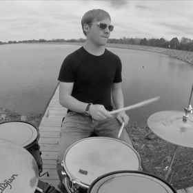 Playing drums on the pier of Lake White State Park.