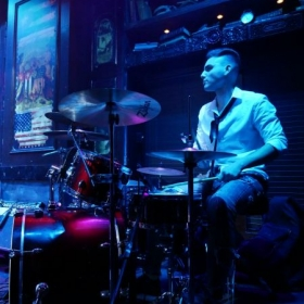 Playing the drums with my band
