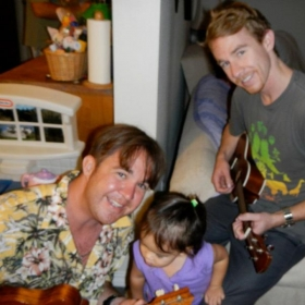 Me and my brother in Hawaii, giving a friend's daughter her first Ukelele lesson :)