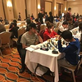 Me (left with gray shirt and black hat) battling it out with my opponent in 2018 Philadelphia Open Championship Match.