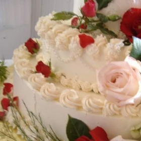 Wedding cake.  Buttercream, fresh roses, pearls.