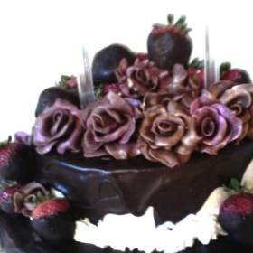 Hand made antique chocolate roses .  Wedding cake