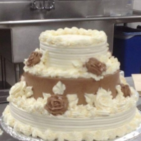 Chocolate Wedding Cake.  Italian Buttercream and Chocolate mousse icing.   Unfinished, but mostly done.