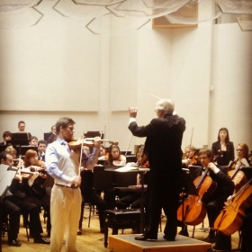 Performing a violin concerto with the University of Wisconsin-Madison Symphony Orchestra.