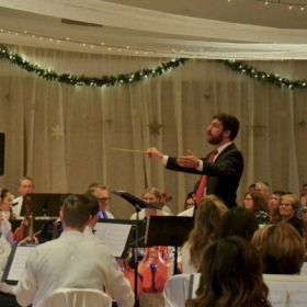 conducting choir and orchestra